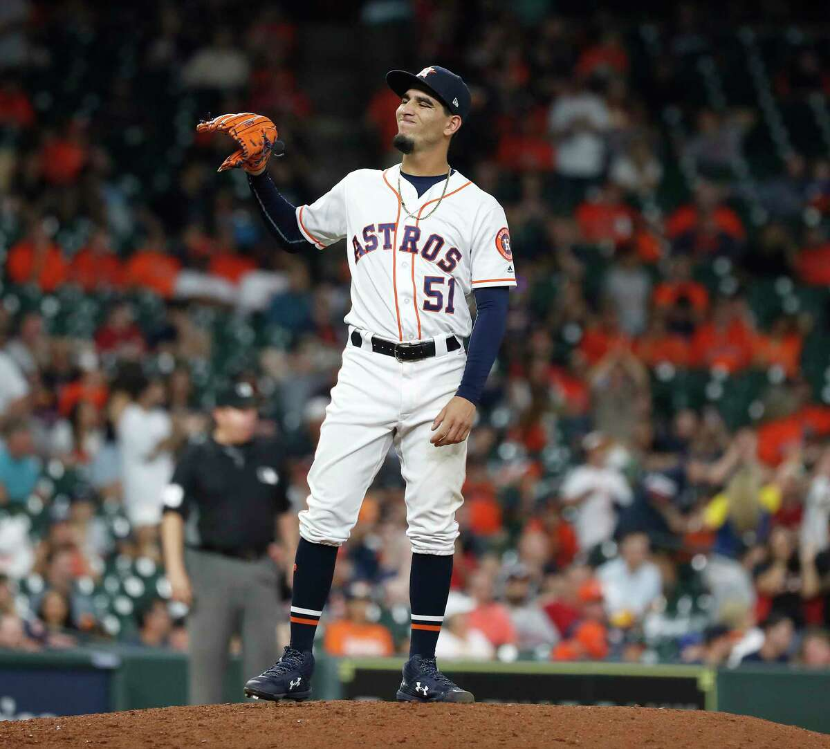 Houston Astros relief pitcher Cionel Perez (51) reacts after giving up a two-run homer to Milwaukee Brewers Mike Moustakas during the fourteenth inning of an MLB baseball game at Minute Maid Park, Wednesday, June 12, 2019.