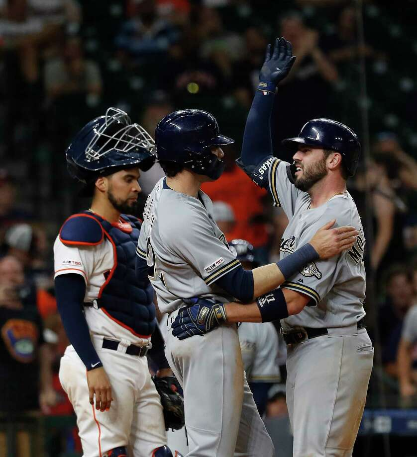 Milwaukee Brewers Mike Moustakas (11) hugs Christian Yelich (22) after he hit a two-run homer during the fourteenth inning of an MLB baseball game at Minute Maid Park, Wednesday, June 12, 2019. Photo: Karen Warren, Staff Photographer / © 2019 Houston Chronicle