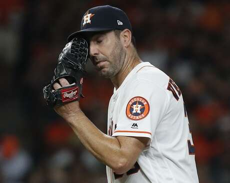 Astros pitcher Justin Verlander laments a game-tying homer surrendered to the Brewers' Eric Thames with two outs in the seventh inning. On a night when he struck out a career-best 15, Verlander allowed only four hits, but three were solo home runs.