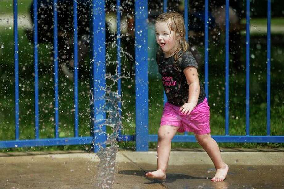 Porsha Letts, 2, runs through the Gerstacker Spray Park on Wednesday afternoon in downtown Midland. (Katy Kildee/kkildee@mdn.net)