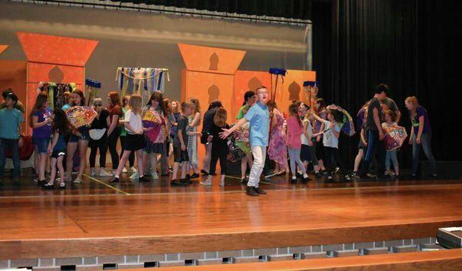 Lucas McKnight (center) performs during practice of Aladdin Jr. (Submitted Photo)