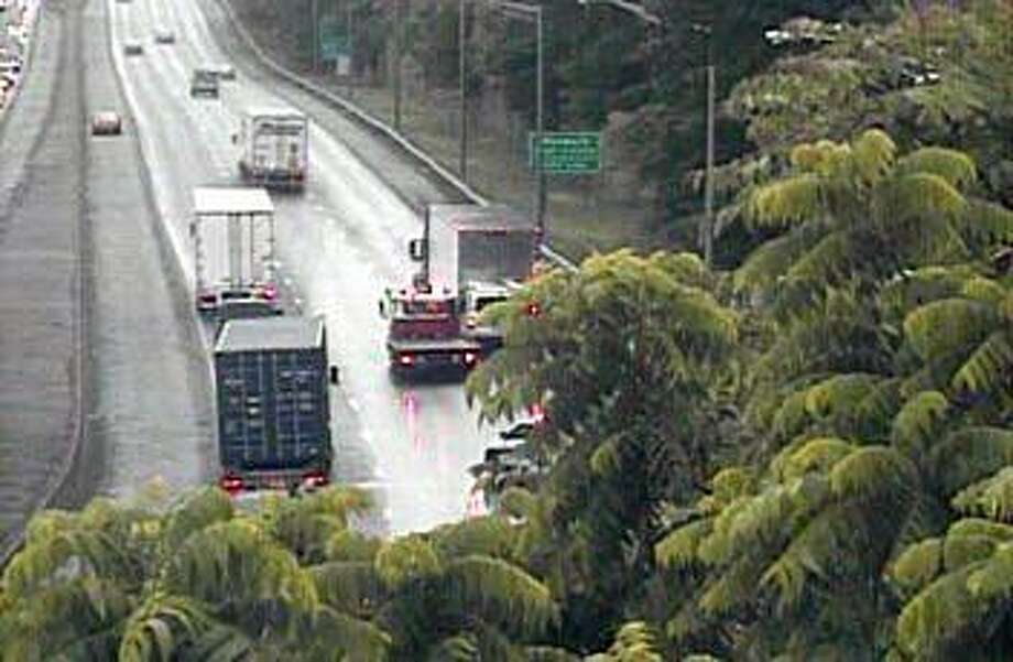 An accident involving a tractor-trailer and another vehicle has closed two southbound lanes of I-95 in Westport on Thursday, June 13, 2019. The right and center lanes are closed between Exits 17 in Westport and 16 in Norwalk. Photo: /