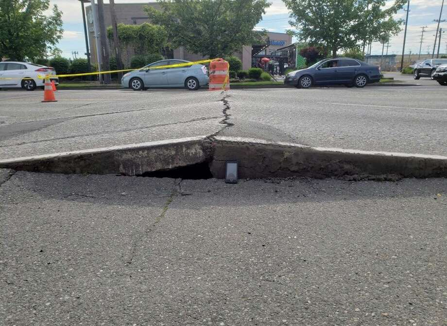 Pictured is the road buckle on 4th Ave S at S Industrial Way that has reduced SB travel to a single right lane, and blocked all NB traffic beginning at S Dawson St. Photo: Courtesy SDOT