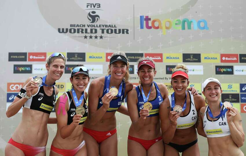 ITAPEMA, BRAZIL - MAY 19: (L-R) Silver medal Sarah Pavan and Melissa Humana-Paredes of Canada, Gold medal Alexandra Klineman and April Ross of the United States and Bronze medal Heather Bansley and Brandie Wilkerson of Canada pose for a photo after the finals in the FIVB World Tour 2019 on May 19, 2019 in Itapema, Brazil.