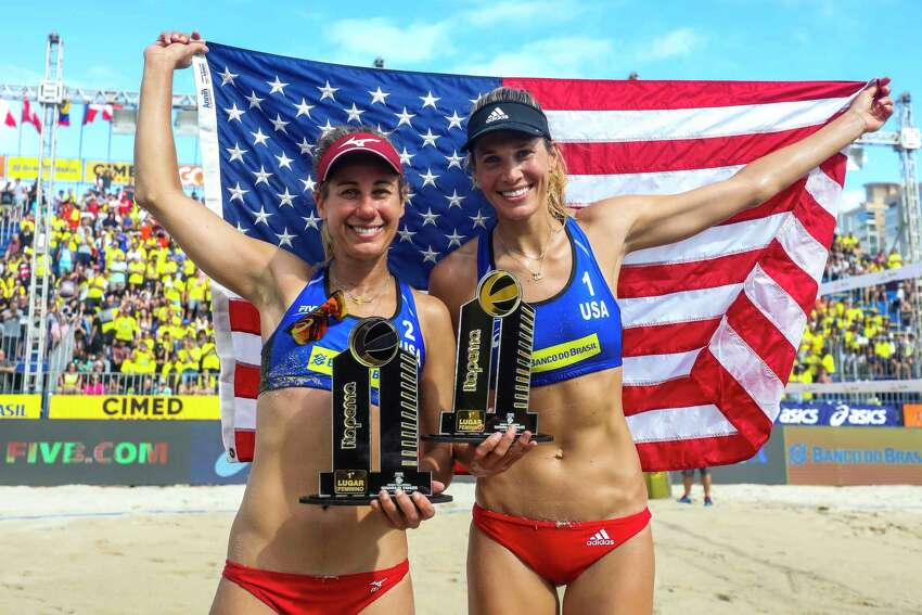 ITAPEMA, BRAZIL - MAY 19: April Ross (L) and Alexandra Klineman of the United States celebrate with the trophy after winning the Women's Final match against Sarah Pavan and Melissa Humana-Paredes of Canada during the FIVB World Tour 2019 on May 10, 2019 in Itapema, Brazil.