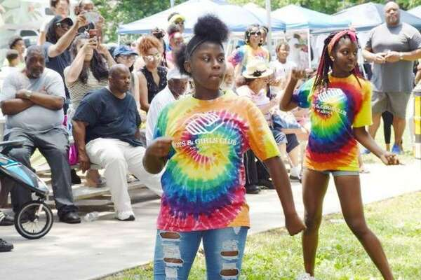A group from the Boys & Girls Club of Alton entertains Juneteenth visitors at last year's celebration. This year's event is 10 a.m. to 5 p.m. Saturday at James Killion Park in Alton.