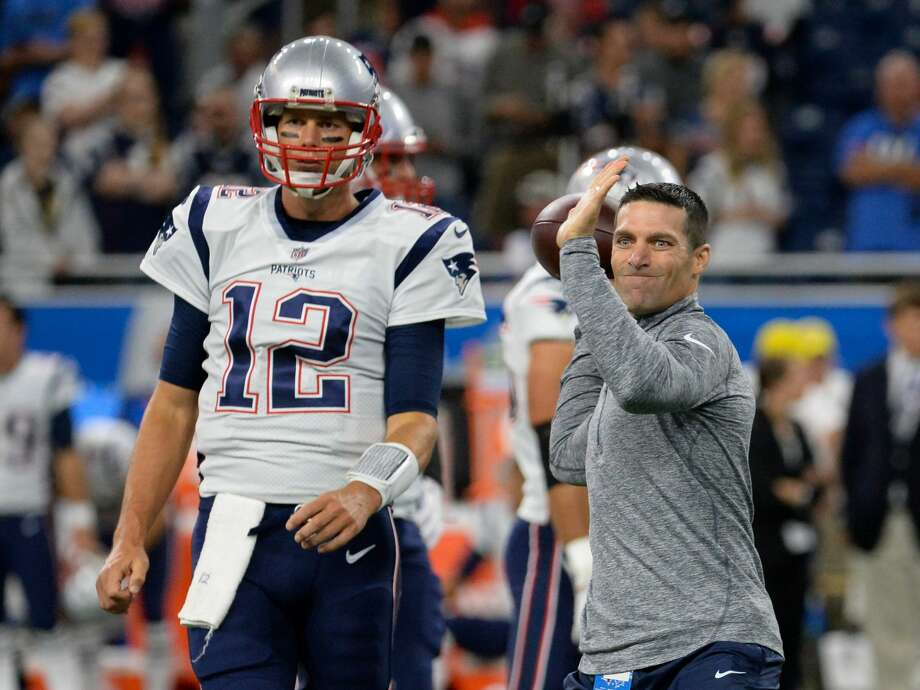 Director of player personnel Nick Caserio throws a pass as quarterback Tom Brady #12 of the New England Patriots looks on prior to a preseason game on August 25, 2017 against the Detroit Lions at Ford Field in Detroit, Michigan. Photo: Diamond Images/Diamond Images/Getty Images