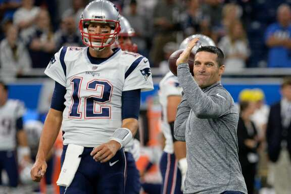 DETROIT, MI - AUGUST 25, 2017: Director of player personnel Nick Caserio throws a pass as quarterback Tom Brady #12 of the New England Patriots looks on prior to a preseason game on August 25, 2017 against the Detroit Lions at Ford Field in Detroit, Michigan. New England won 30-28. (Photo by: 2017 Nick Cammett/Diamond Images/Getty Images)
