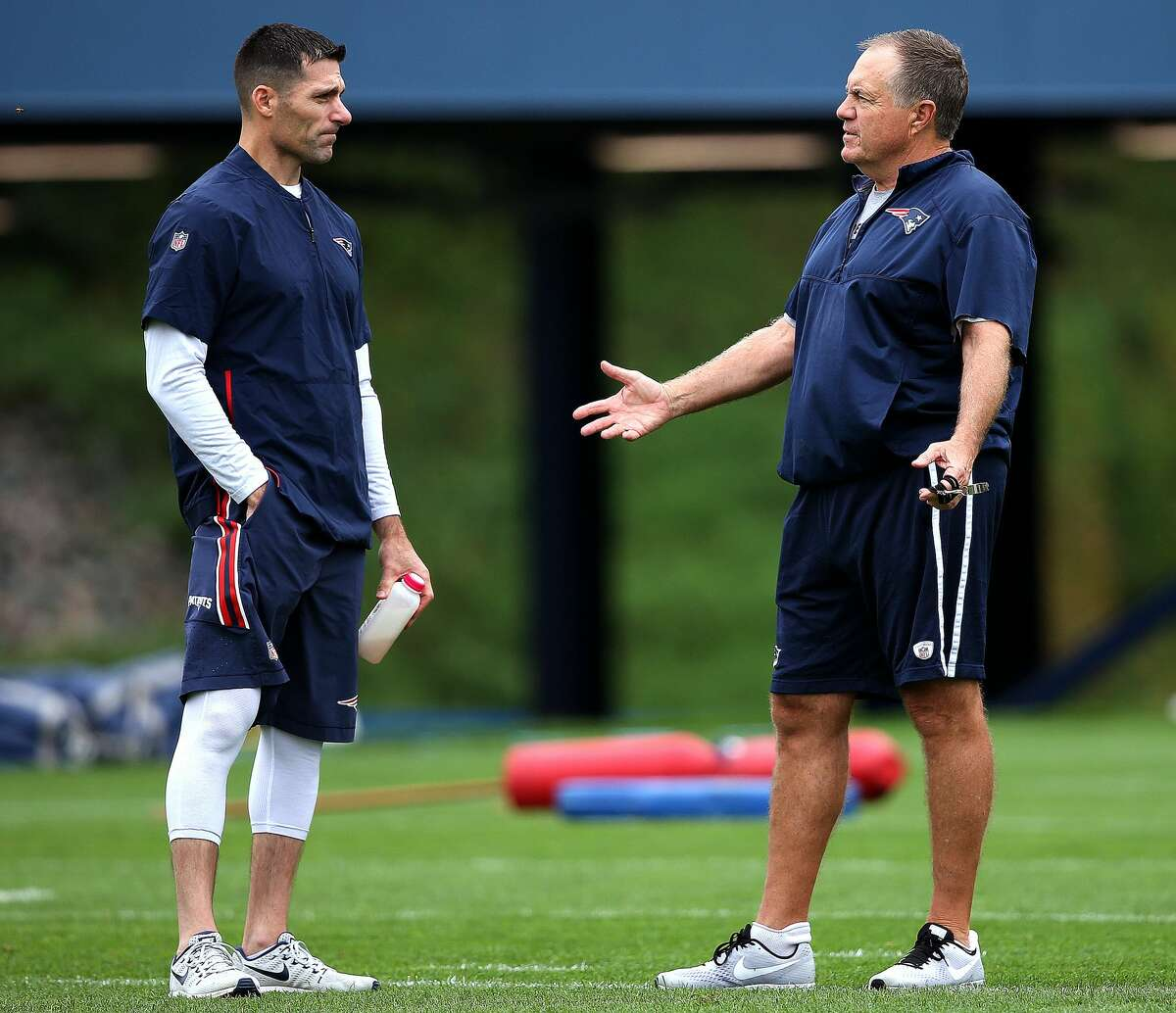 New England Patriots Director of Player Personnel Nick Caserio, left, stands with head coach Bill Belichick during New England Patriots practice at the Gillette Stadium practice facility in Foxborough, MA on Sep. 13, 2018.