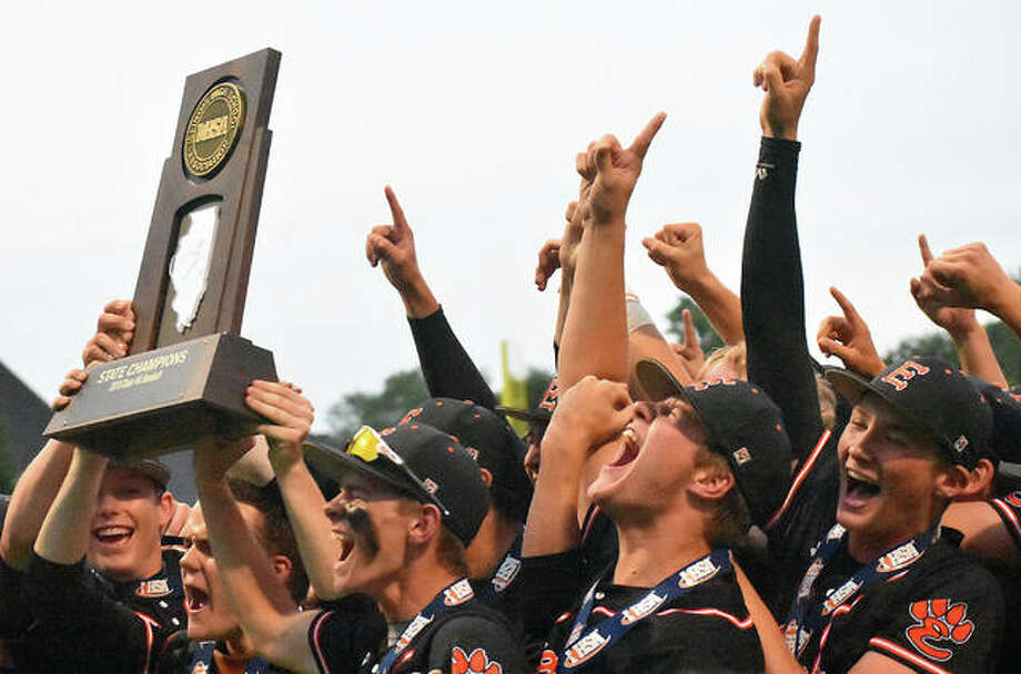 Edwardsville celebrates with the Class 4A state championship trophy after defeating St. Charles North in the title game in Joliet.