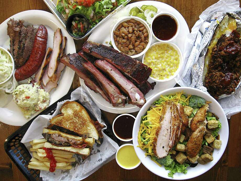 The menu at B&B Smokehouse ranges from smoked meats to sandwiches, salads, sides and chalupas. Photo: Mike Sutter /Staff