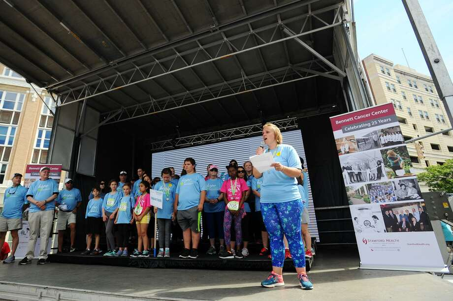 Toquam Magnet Middle School prinicpal Amy Beldotti, a cancer survivor, speaks before the 22nd annual Hope in Motion Walk & Run in Columbus Park in Stamford, Conn. on Cancer Survivor's Day, Sunday, June 4, 2017. Photo: Michael Cummo / Hearst Connecticut Media / Stamford Advocate