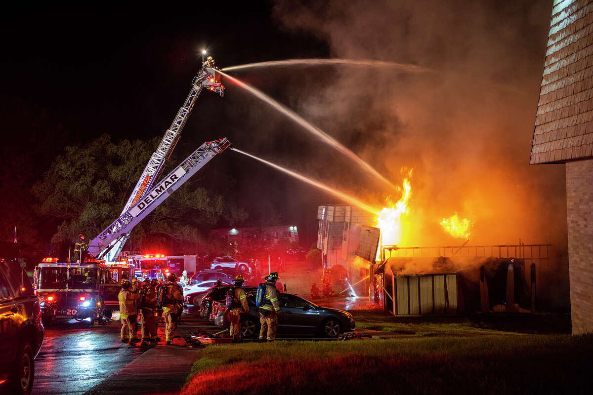 Flames pour from a building at the Meadowbrook Apartment complex in Bethlehem early Tuesday where an adult died.
