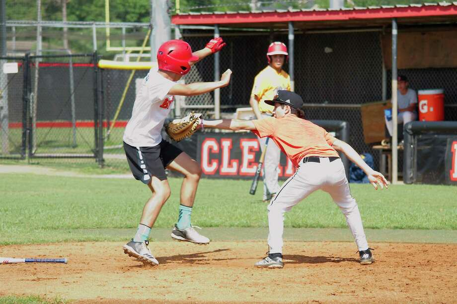 Dylan Medina tries to avoid the tag from Eden Diaz during a mock game drill Wednesday at the Clear Brook summer baseball camp. Photo: Kirk Sides / Staff Photographer / © 2019 Kirk Sides / Houston Chronicle