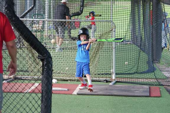 Conner Patrick has his eyes glued to the ball Wednesday at the Clear Brook summer baseball camp.