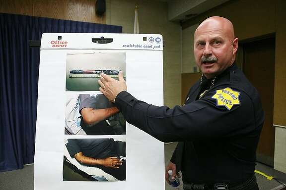 Fresno Police Chief Jerry Dyer shows the baseball bat on Thursday, April 17 , 2008 that was used in Wednesday's assault at Roosevelt High School.  Junus Perry shot and killed a Carrizales Wednesday after the teenager attacked the officer with a baseball bat on campus, authorities said. (AP Photo/The Fresno Bee,Tomas Ovalle)