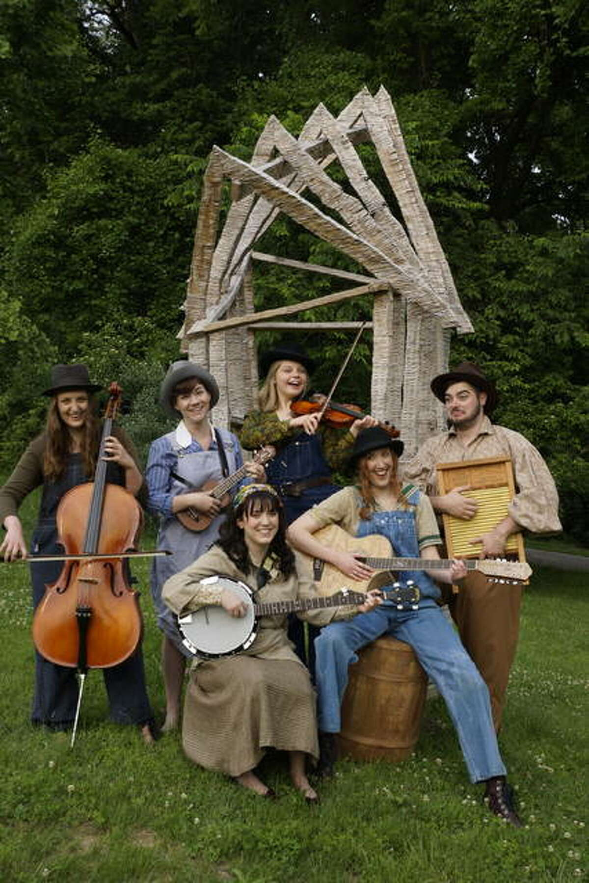 """Summer Baer (banjo) and Lisa Hinrichs (guitar), and back row, from left, Sara Naumann (cello), Ashley Bauman (ukulele), Sarah Lantsberger (fiddle) and David Zimmerman (washboard) in """"As You Like It,"""" as part of Southern Illinois University Edwardsville's Summer Theater Festival."""