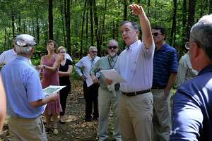 File photo of Joel Lindsay, with Ameresco Candlewood Solar LLC, leading a walking tour for the state Siting Council of the area where there is a proposal to build solar panels on Candlewood Mountain in New Milford, Tuesday, Sept. 26, 2017.
