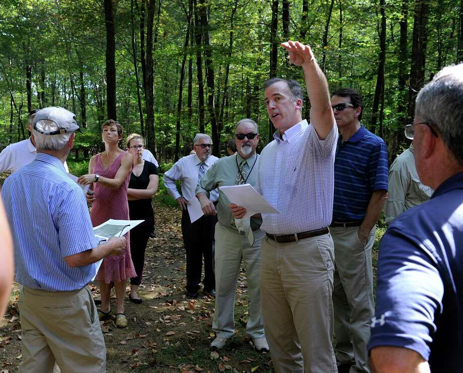 Joel Lindsay, with Ameresco Candlewood Solar LLC, leads a walking tour for the state Siting Council of the area where there is a proposal to build solar panels on Candlewood Mountain in New Milford, Tuesday, Sept. 26, 2017. Photo: Carol Kaliff / Hearst Connecticut Media / The News-Times
