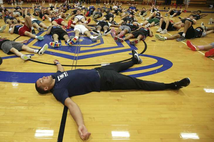 The Orlando Magic's Aaron Gordon joins teen basketball players during a Train the Mind meditation session at Our Lady of the Lake University. Train the Mind encourages young players to accept their mistakes and be in the moment when they play.