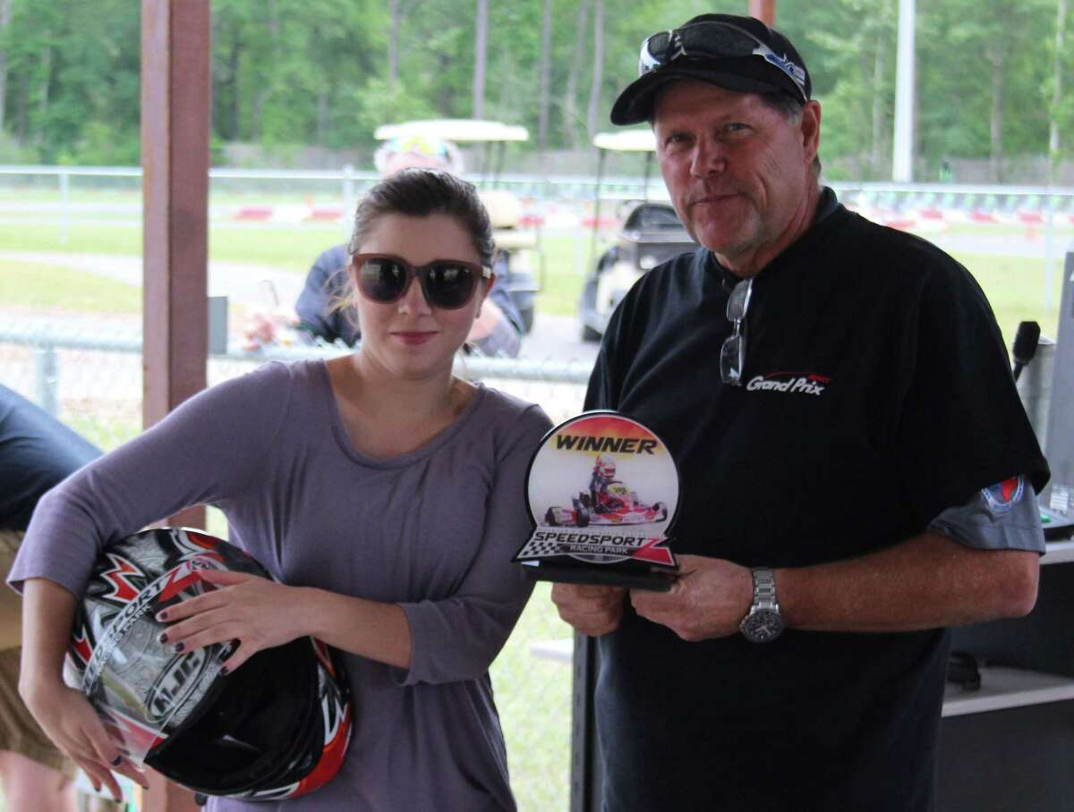 Lauren Bullock (left) is presented with a trophy by Greater East Montgomery County Chamber President Rick Hatcher (right) at the second annual Grand Prix held on April 20.