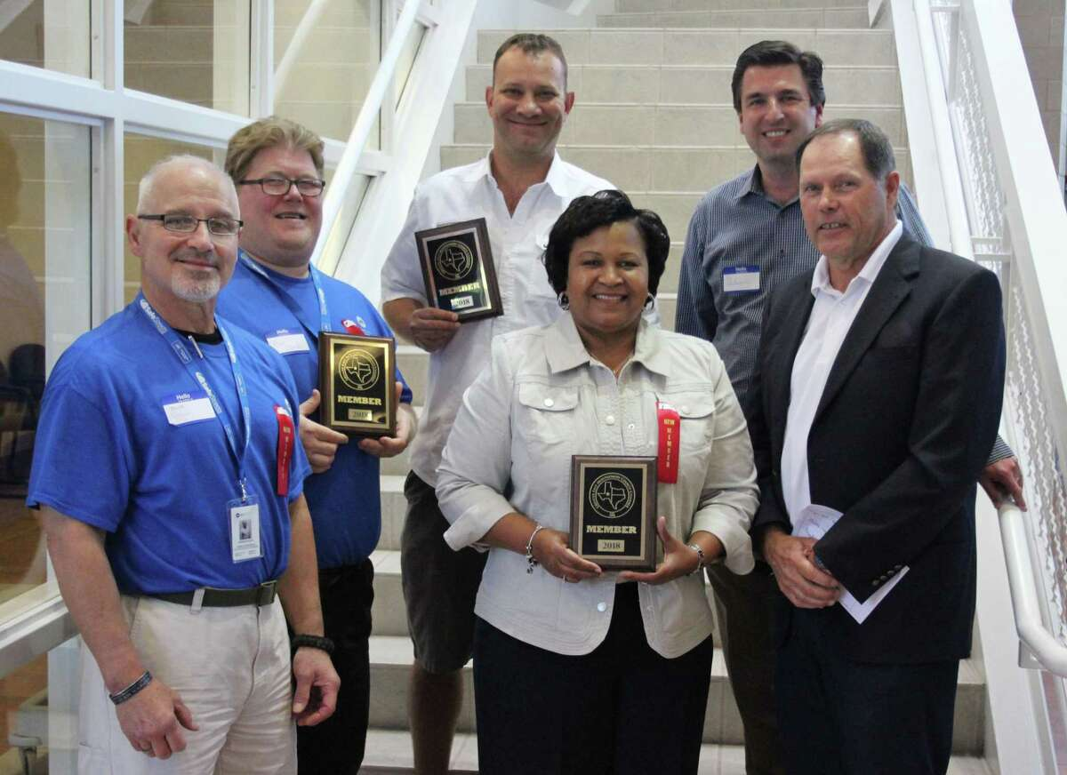 The Greater East Montgomery County Chamber of Commerce welcomed three new members at the April 4 luncheon. Left to right: Charles Gonzales and Adam Johnson of ADT, Matt Erickson of Freedom Self Storage, Janice Hays of Grand Parkway Infrastructure, Chamber Chairman Jon Unterreiner and Chamber President Rick Hatcher.