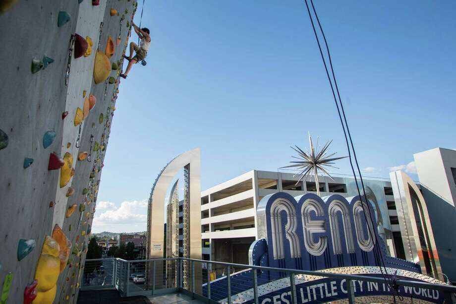 Robert Springs climbs at the base of the artificial climbing wall on the outside of the Whitney Peak Hotel in Reno, Nevada, on June 4, 2019. Photo: Photo For The Washington Post By Tiffany Brown Anderson / Tiffany Brown Anderson