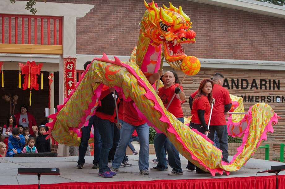 Parents and Teachers formed a dragon dance troupe to perform at the Mandarin Chinese Language Immersion Magnet School's Chinese New Year Festival in this file photo. Chung Ying has been selected as the new principal of Mandarin Immersion Magnet School. Photo: R. Clayton McKee, Freelance / For The Chronicle / © R. Clayton McKee
