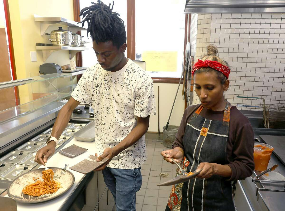 General Manager DeHandre Weaver (left) and owner / creator Azalina Eusope taste noodles cooked on new pans first used in Mahila on Wednesday June 12, 2019 in San Francisco, California.  Mahila, the first full service Mamak (Indian) Muslim restaurant ever opened in San Francisco.