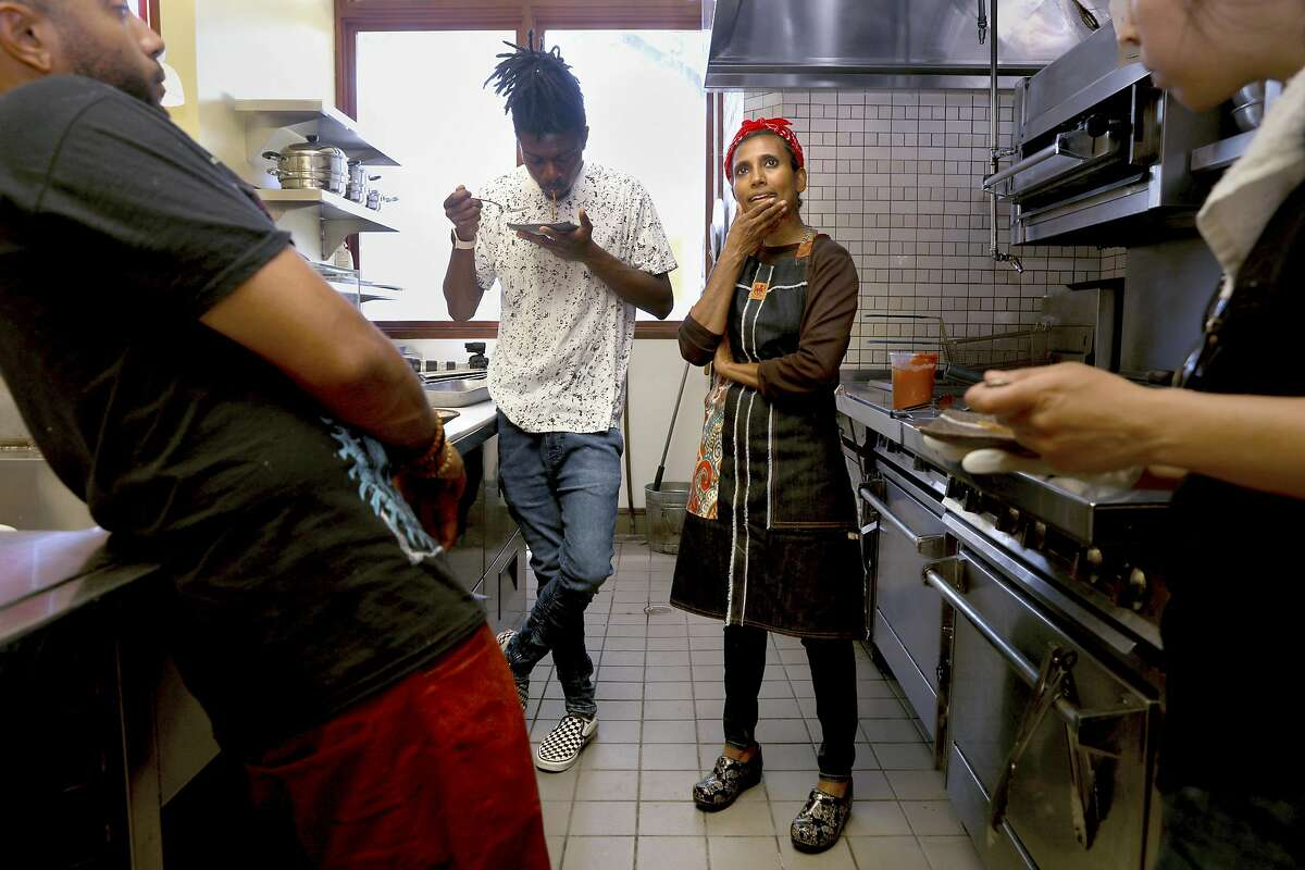 Left to Right - Cook Ronny Randleman, General Manager DeHandre Weaver, owner / creator Azalina Eusope, and bartender Liz Garcia taste pasta on new pans for the first time on Wednesday, June 12, 2019 in San Francisco, Calif., Mahila , the first full-service Mamak (Indian Muslim) restaurant to ever open in San Francisco.