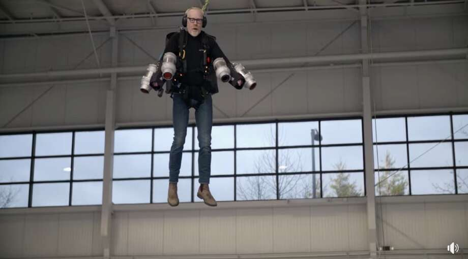 Adam Savage attempts to fly in a suit he built to function like that belonging to Iron Man. Photo: Discovery