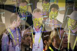FILE -- Attendees interact with a facial recognition demonstration during the Consumer Electronics Show in Las Vegas, Jan. 8, 2019. The San Francisco board of supervisors has enacted the first ban by a major American city on the use of facial recognition technology by police and other municipal agencies. (Joe Buglewicz/The New York Times)