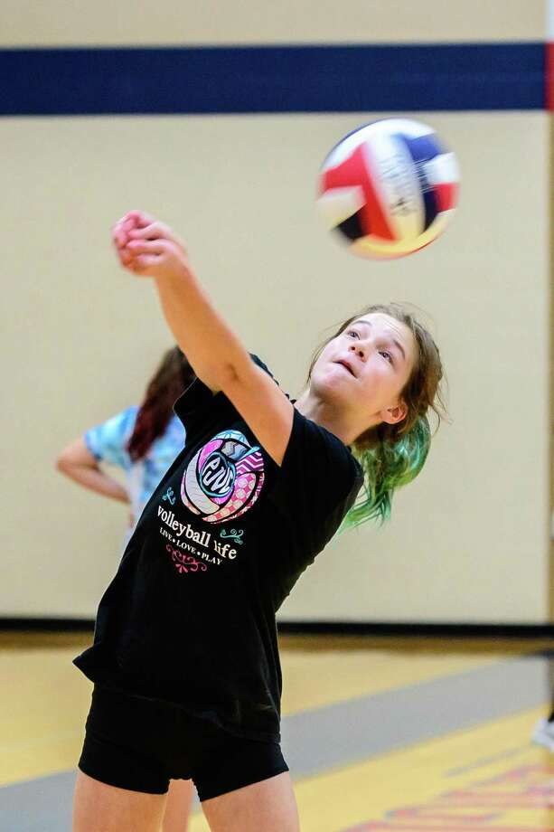 Kinley Epperson, 13 bumps the ball up during volleyball camp action at Dawson High School. (Photos: Kim Christensen) Photo: Kim Christensen, Photographer / Kim Christensen / Copyright Kim Christensen