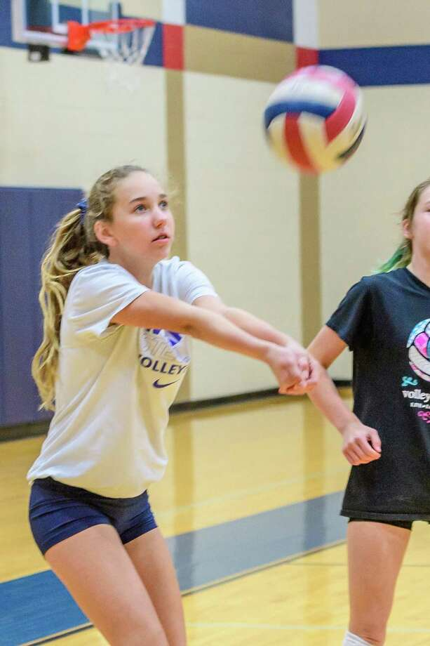 Meredith Beeson, 13, bumps the ball during a volleyball camp this week at Dawson High School. (Photos: Kim Christensen) Photo: Kim Christensen, Photographer / Kim Christensen / Copyright Kim Christensen