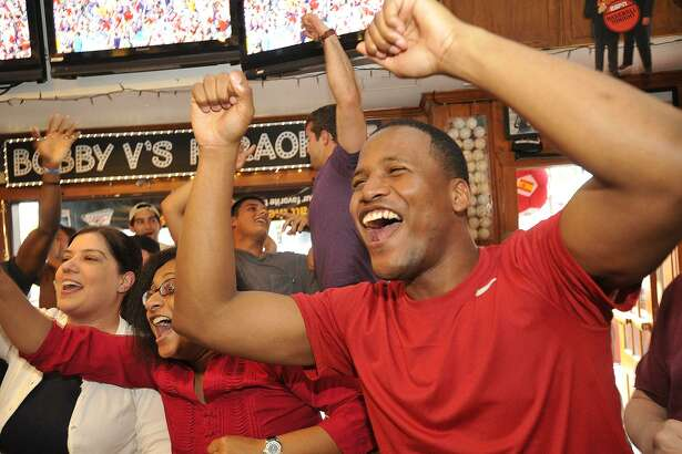 Dwaine Campbell celebrates after the US National Team scores their second goal during their World Cup first round game against Ghana at Bobby V's Sports Bar in Stamford, Conn., on Monday, June 16, 2014. USA won, 2-1.