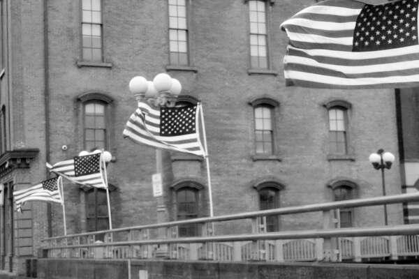Flags wave in the wind on Saugatuck River Bridge in Westport. Taken June 13, 2018.