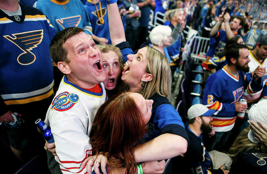 Blues fans at a watch party at Enterprise Center in St. Louis celebrate as the clock hits zero and the Blues won the Stanley Cup over the Boston Bruins in Boston. A parade to honor the Stanley Cup champion Blues will be held in downtown St. Louis beginning at noon Saturday. Photo: AP Photo