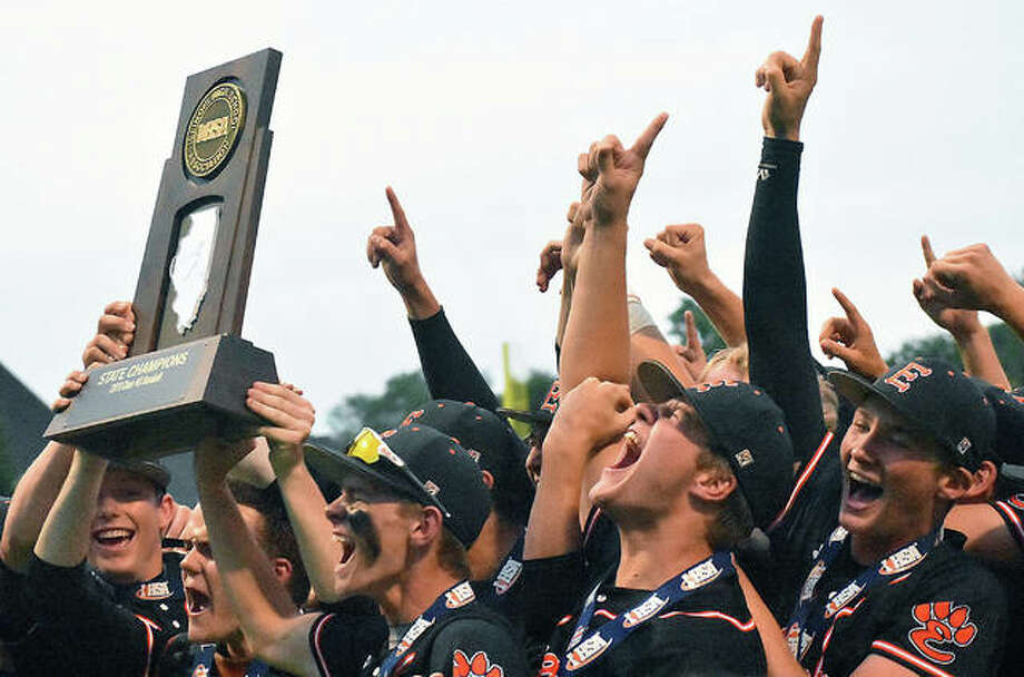 Edwardsville players celebrate with the Class 4A state championship trophy after defeating St. Charles North in the title game in Joliet. Photo: Matt Kamp | For The Telegraph