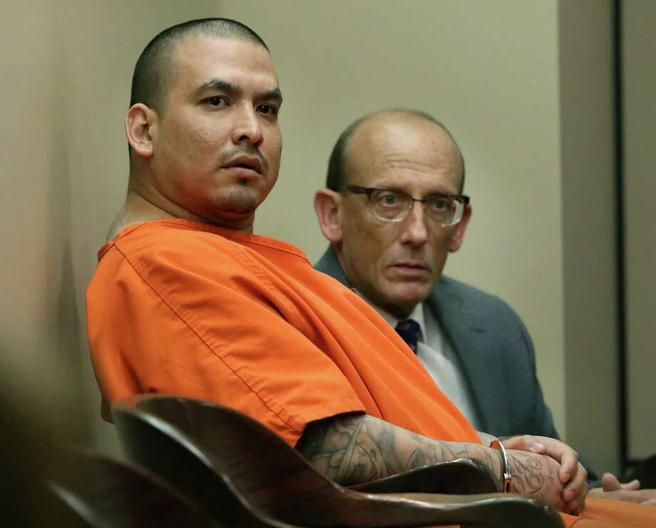 Christian Martinez, left, with his lawyer Scott McCrum, was sentenced after agreeing to a plea in the fatal stabbing of this wife, Monica Martinez, in the 175th State District Court at the Cadena-Reeves Justice Center, on Thursday, June 13, 2019 Photo: Bob Owen, Staff Photographer / Staff Photographer / ©2019 San Antonio Express-News