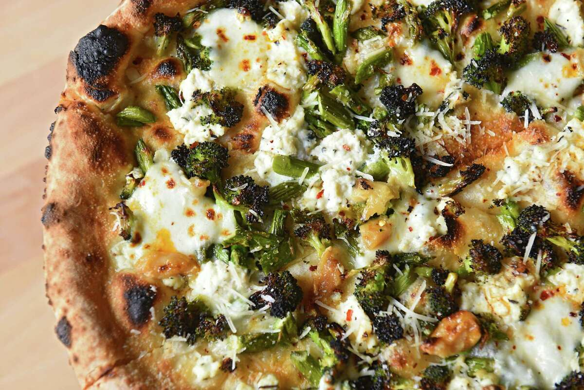 Green goddess pizza; charred broccoli, asparagus, roasted garlic, chili flakes, chili oil, herb ricotta, fresh mozzarella at Flatbread Social on Thursday, April 11, 2019 in Saratoga Springs, N.Y. (Lori Van Buren/Times Union)