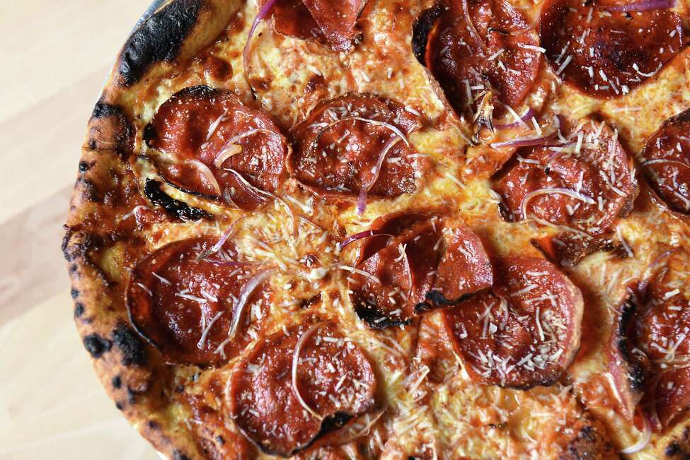 Pepperoni in her eyes and cheese in her heart pizza; pepperoni, sliced red onions, fire roasted tomato sauce mozzarella at Flatbread Social on Thursday, April 11, 2019 in Saratoga Springs, N.Y. (Lori Van Buren/Times Union)