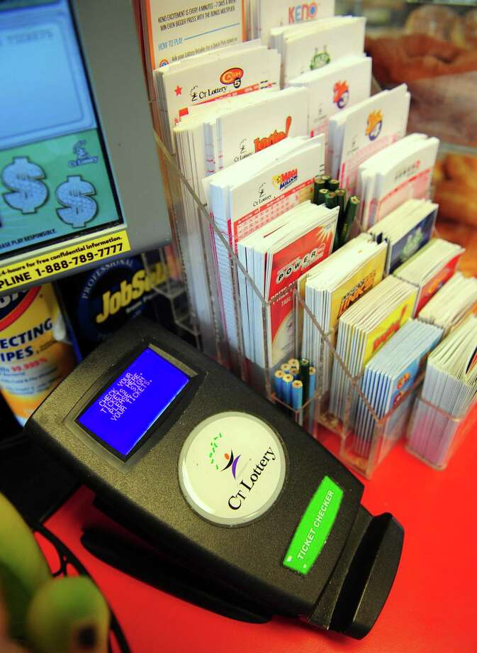 CT Lottery games on sale at the Food Bag Citgo gas station in Shelton, Conn., on Friday Aug. 19, 2016. The lottery has had a very good year. Three unclaimed Powerball tickets for $1 million each was moved to the state's General Fund. Photo: Christian Abraham / Hearst Connecticut Media / Connecticut Post
