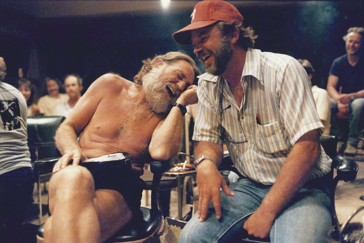 """Bill Wittliff and Willie Nelson, seen here in 1985 on the set of """"Red Headed Stranger,"""" were friends for many years."""