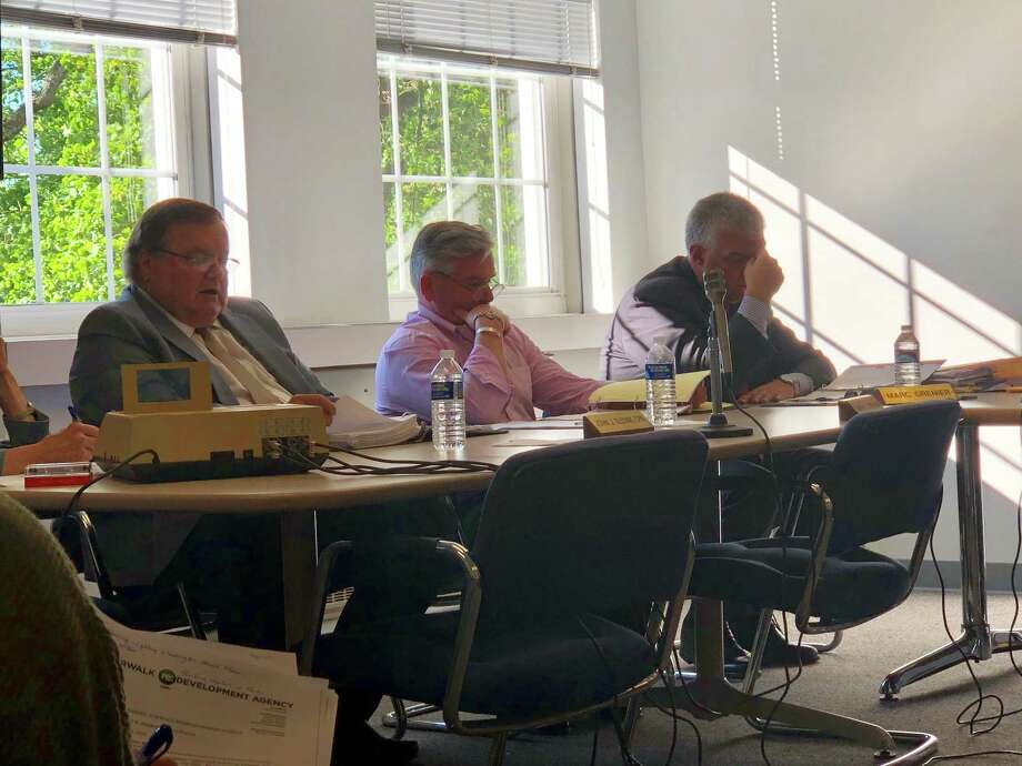 Outgoing Executive Director Tim Sheehan and Comptroller John Slovak discuss the agency's financial situation at the Norwalk Redevelopment Agency meeting on Tuesday, June 11, 2019. Photo: Kelly Kultys / Hearst Connecticut Media
