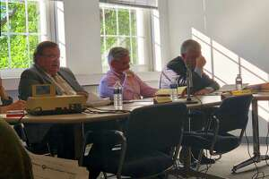 Outgoing Executive Director Tim Sheehan and Comptroller John Slovak discuss the agency's financial situation at the Norwalk Redevelopment Agency meeting on Tuesday, June 11, 2019.