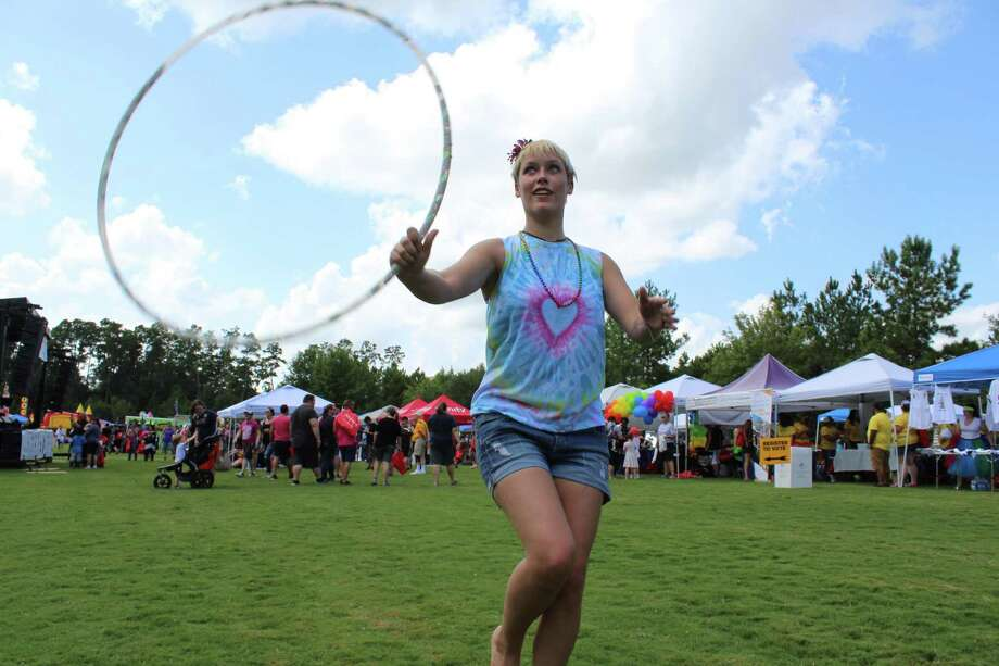 Jollee Carden, 13, of Willis and Hoop Dance Instructor Stephanie Oldmixon were two of an estimated 1,200 people who attended the inaugural Pride Festival in The Woodlands on Saturday, September 8 at Town Green Park in The Woodlands. Photo: Meagan Ellsworth / Meagan Ellsworth