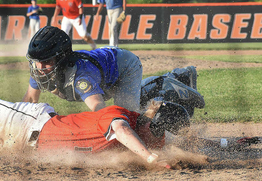 Edwardsville's Gavin Huebner slides safely across home plate during Tuesday's game against Jerseyville at Tom Pile Field.