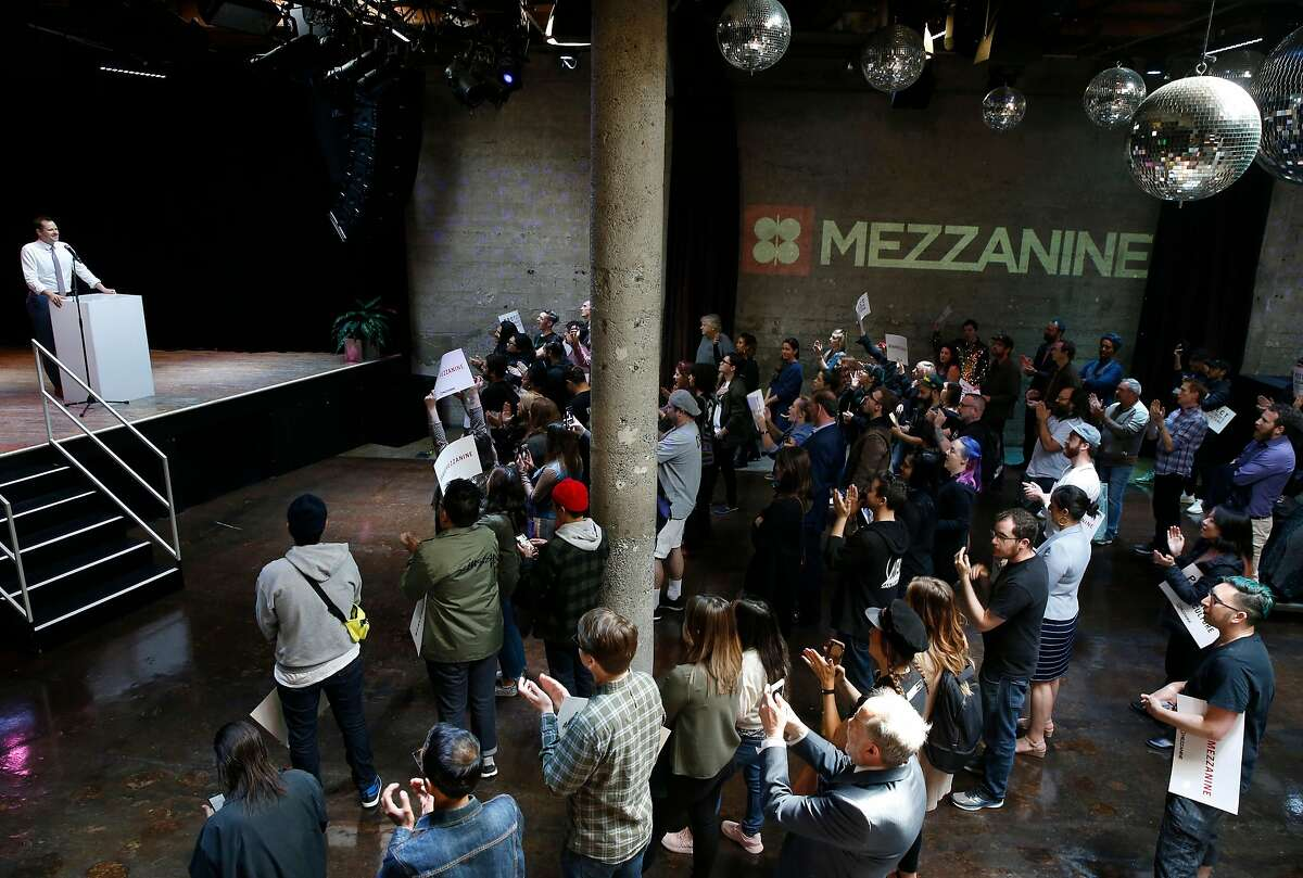 San Francisco supervisor Matt Haney appears on stage at a rally to save the Mezzanine nightclub on Jessie Street in San Francisco in 2019. 2020 has been an even harder year for nightclubs due to the shutdown caused by the pandemic.