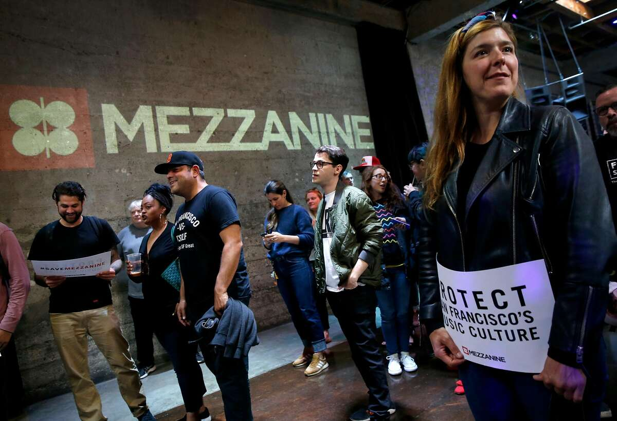 Eva Kane (right), a bartender at Mezzanine for six years, waits for a rally to save the nightclub on Jessie Street to begin in San Francisco, Calif. on Thursday, June 13, 2019. Supervisor Matt Haney is introducing legislation which would make it difficult for nightclub venues to be rezoned and redeveloped for residential use.