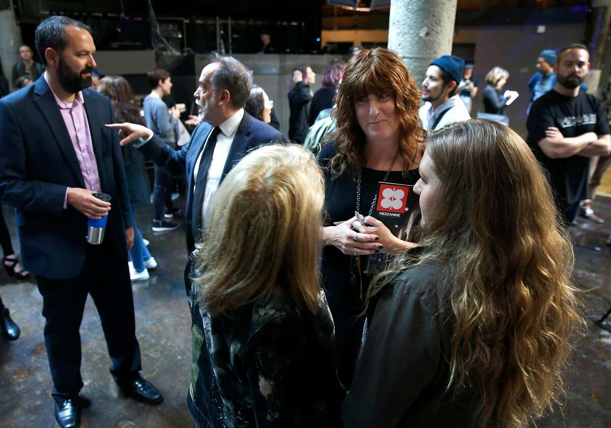 Mezzanine owner Deborah Jackman (center) greets supporters at her nightclub on Jessie Street in San Francisco, Calif. on Thursday, June 13, 2019. Supervisor Matt Haney is introducing legislation which would make it difficult for nightclub venues to be rezoned and redeveloped for residential use.